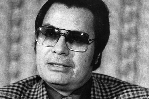 FILE - This Jan. 1976 photo shows the Rev. Jim Jones, pastor of peoples Temple in San Francisco. The cremated remains of nine victims of a 1978 mass cult suicide-murder in Jonestown, Guyana, have turned up in a former funeral home in Delaware, officials said Thursday, Aug. 7, 2014. The state Division of Forensic Science has taken possession of the remains and is working to make identifications and notify relatives, the agency and Dover police said in a statement. On Nov. 18, 1978, Jones orchestrated a ritual of mass murder and suicide in Jonestown, Guyana. Bodies of 911 massacre victims were brought to Dover Air Force Base, home to the U.S. military's largest mortuary. Many of the bodies were decomposed and could not be identified. (AP Photo/File)