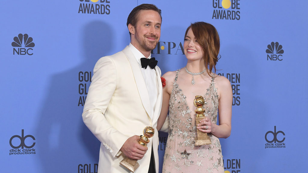 """BEVERLY HILLS, CA - JANUARY 08:  Actors Ryan Gosling and Emma Stone, winners for Best Actor and Best Actress in a Musical or Comedy Film for """"La La Land"""", pose in the press room during the 74th Annual Golden Globe Awards at The Beverly Hilton Hotel on January 8, 2017 in Beverly Hills, California.  (Photo by Kevin Winter/Getty Images)"""